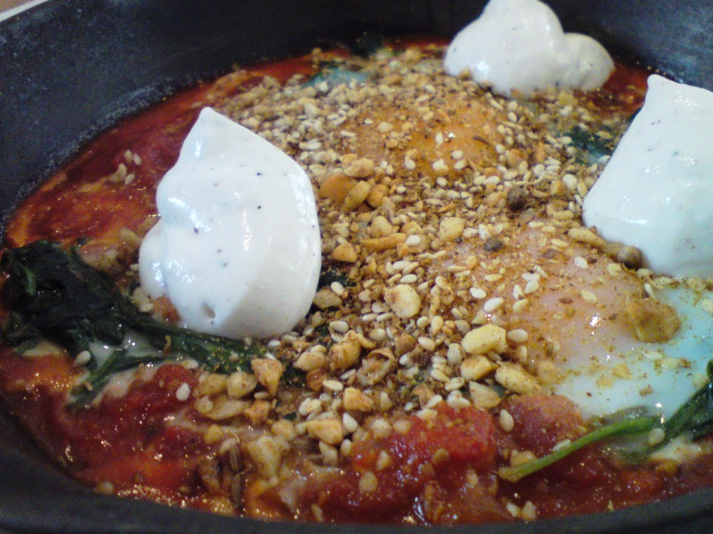 cummulis inc Turkish baked eggs, spiced tomato, dukkah and labne close up