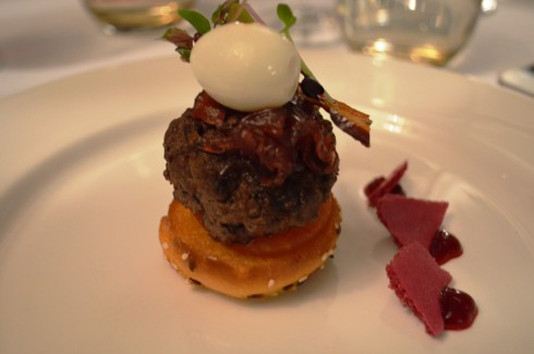F1 Wagyu open burger, toasted brioche, quail egg, onion jam and beetroot crisps by Sharn Greiner